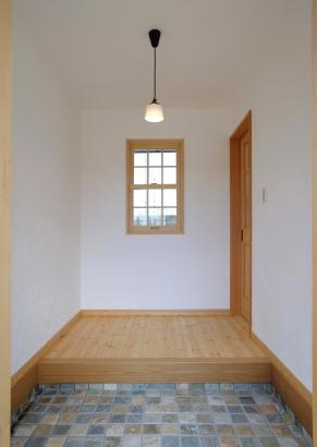レンガ調ブロックを敷いたクラシカルな玄関